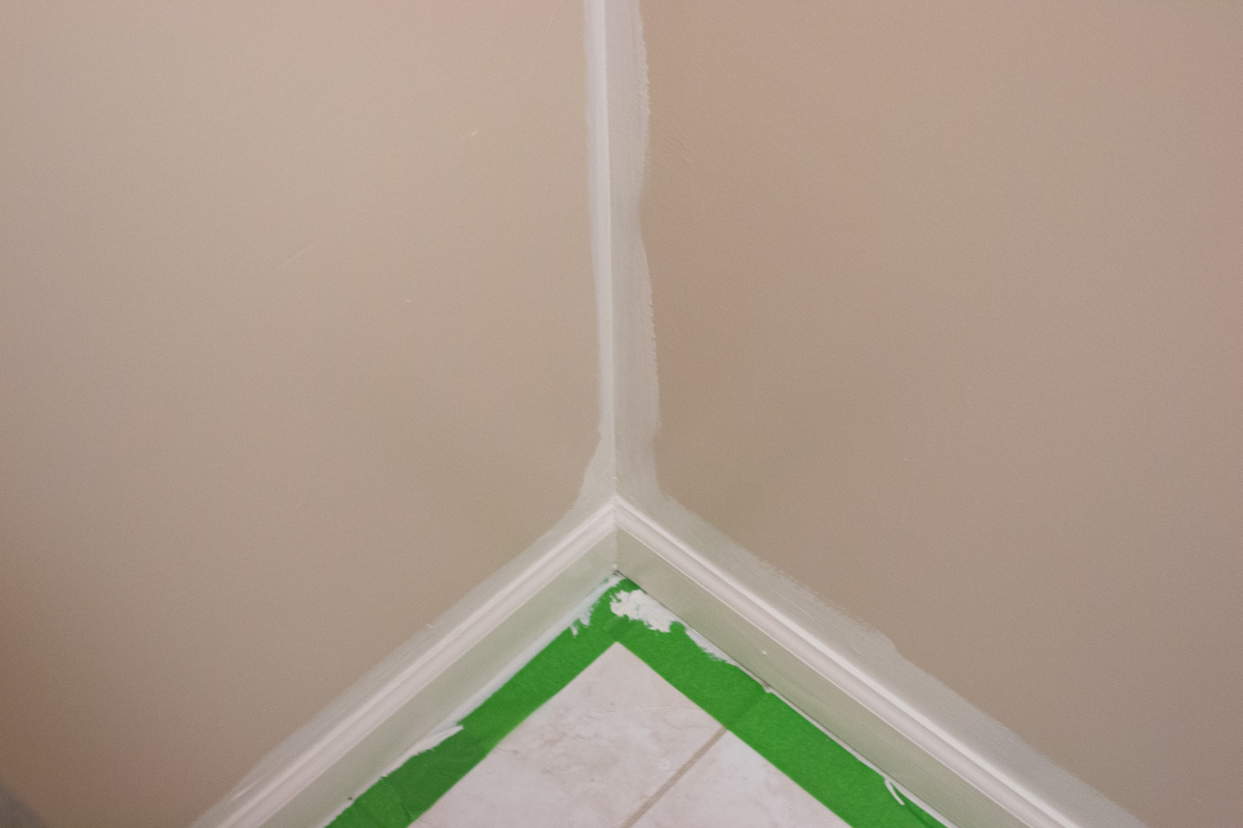 Cutting in the corners of a bathroom with a brush