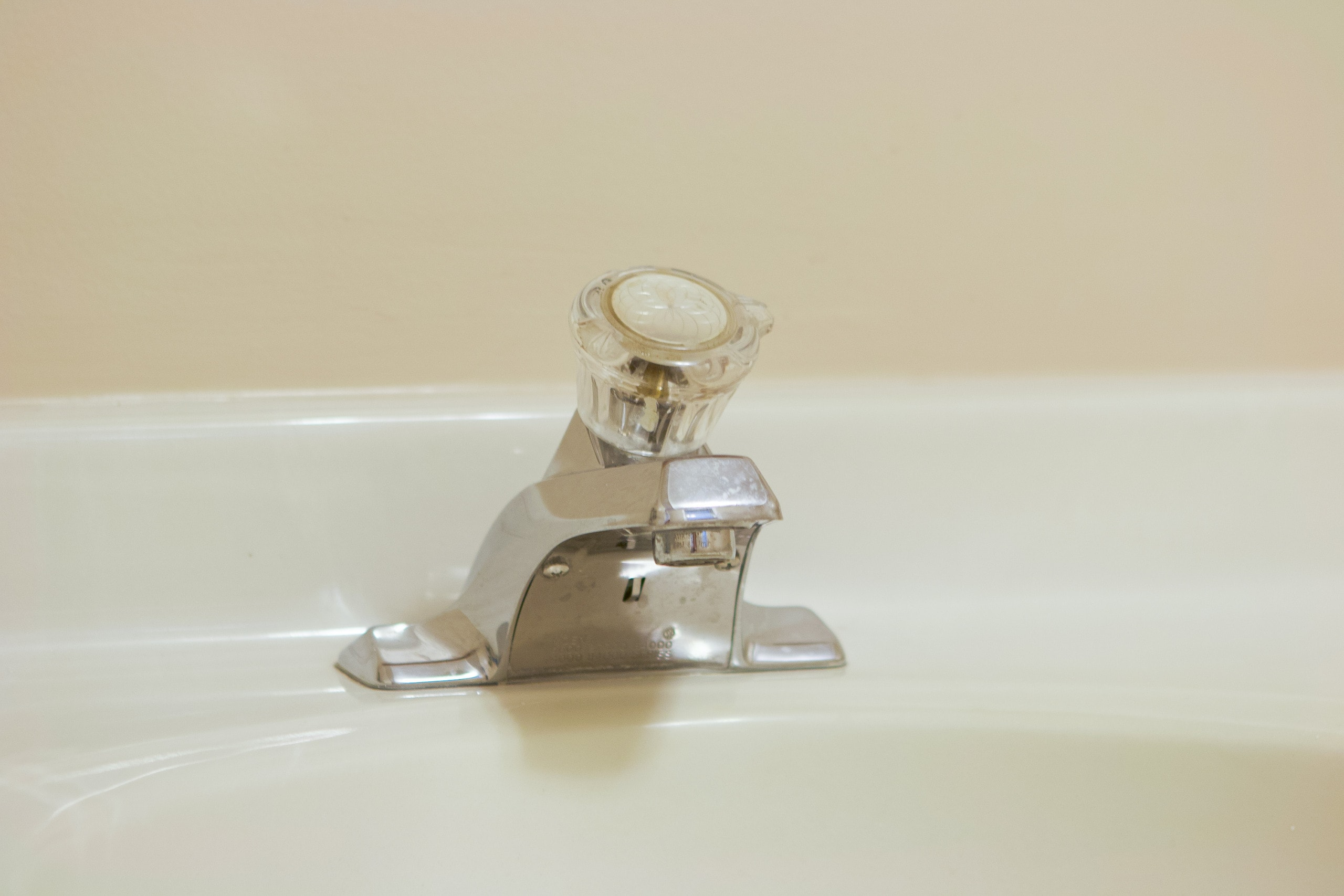 outdated faucet in our basement bathroom