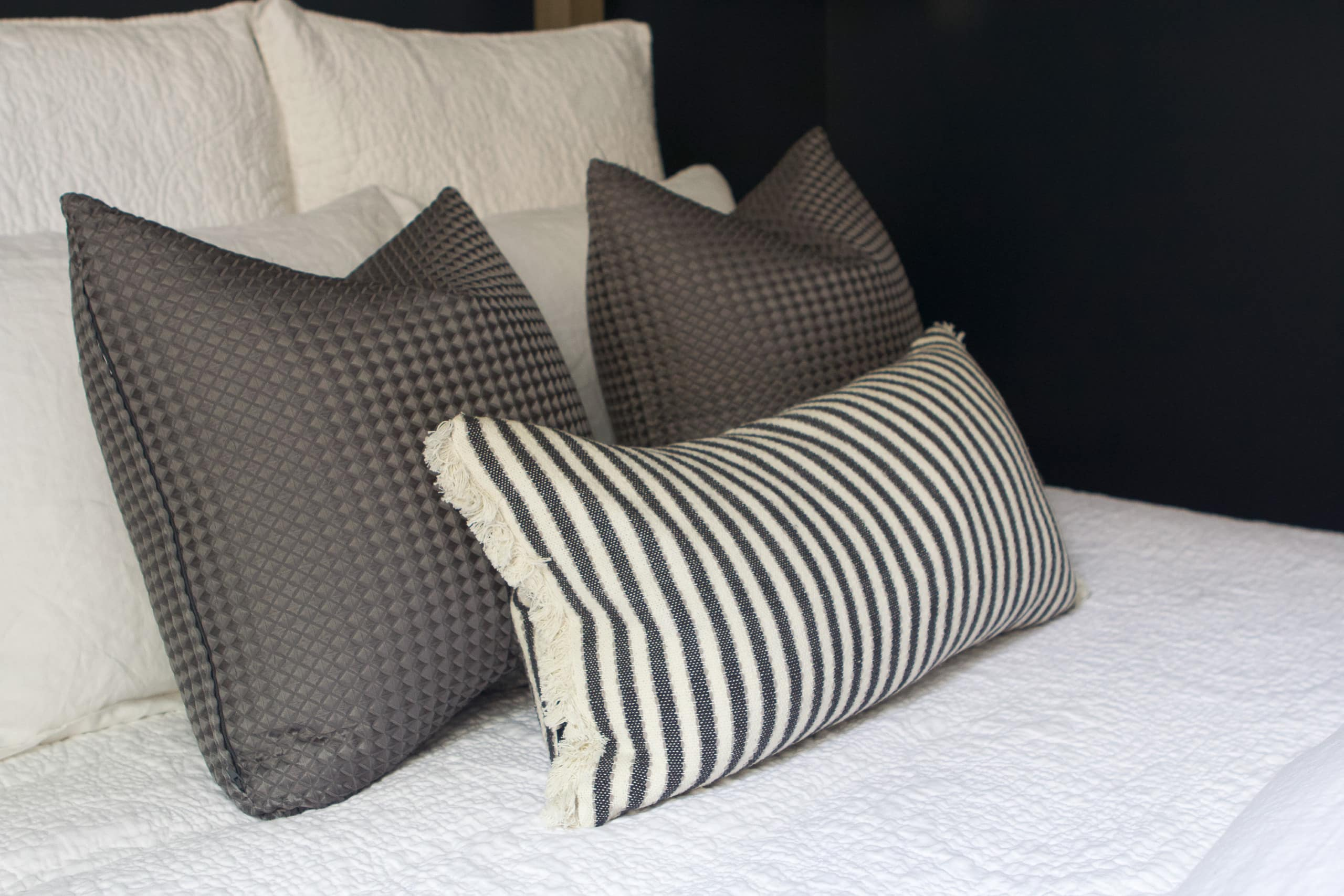 Add some throw pillows to the guest room bed