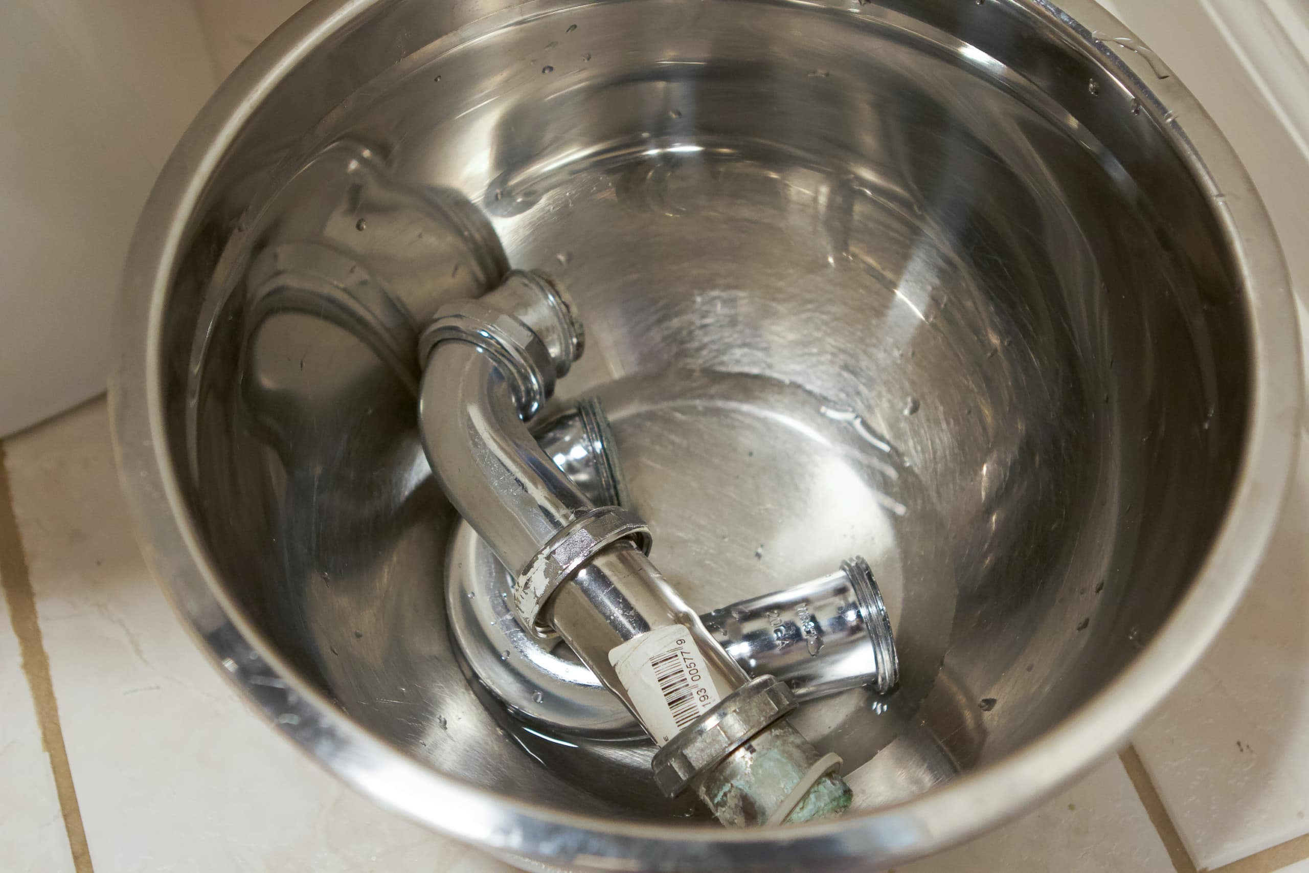 when you install a bathroom faucet, take out the p-trap first