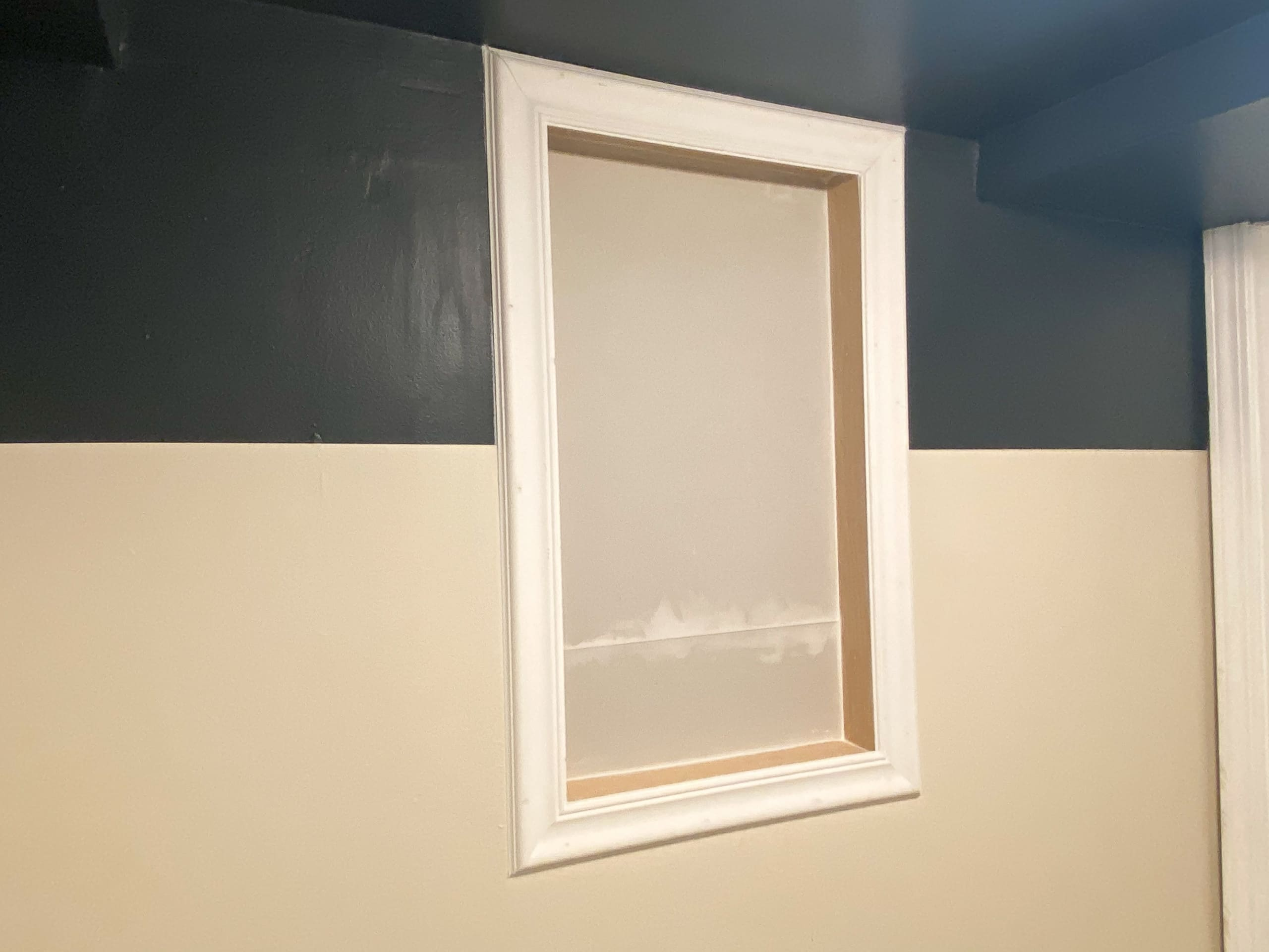 Adding trim to our basement window shelves
