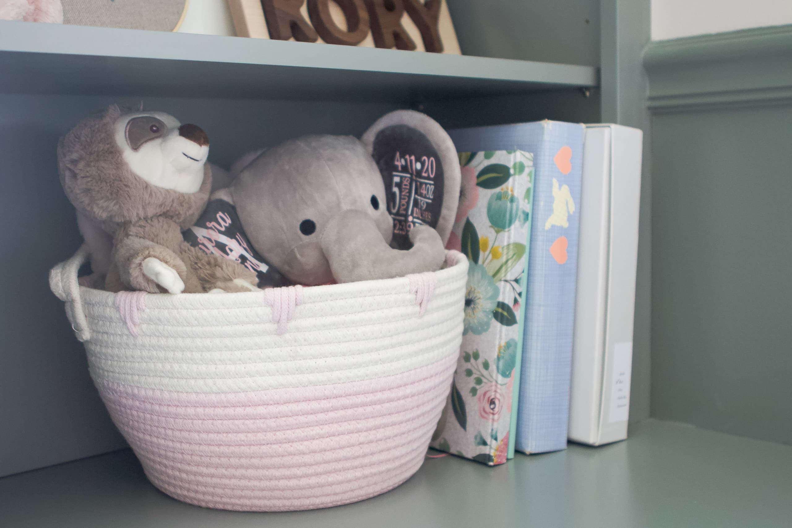 Use baskets to corral items on nursery shelves