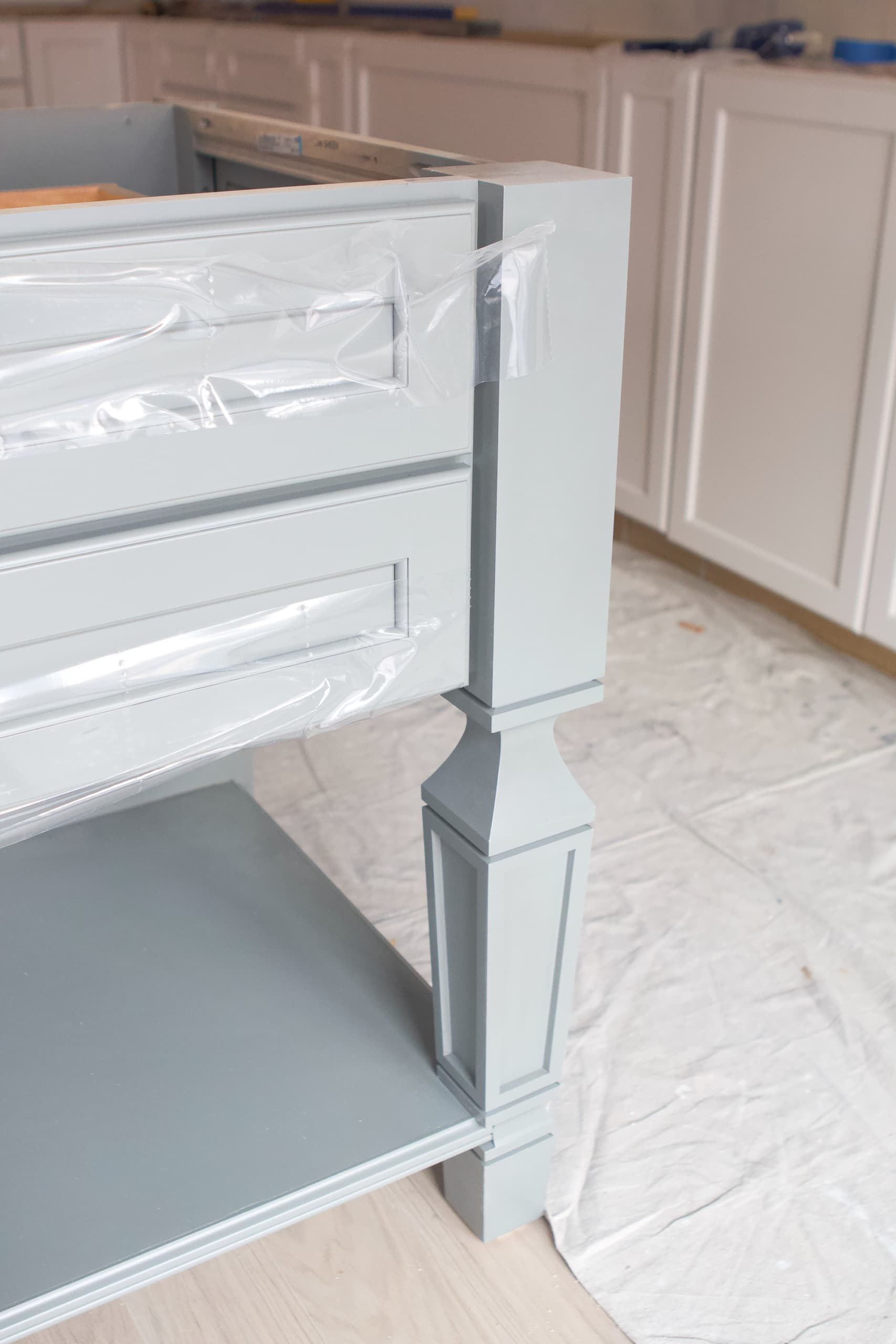Decorative legs on a kitchen cabinet