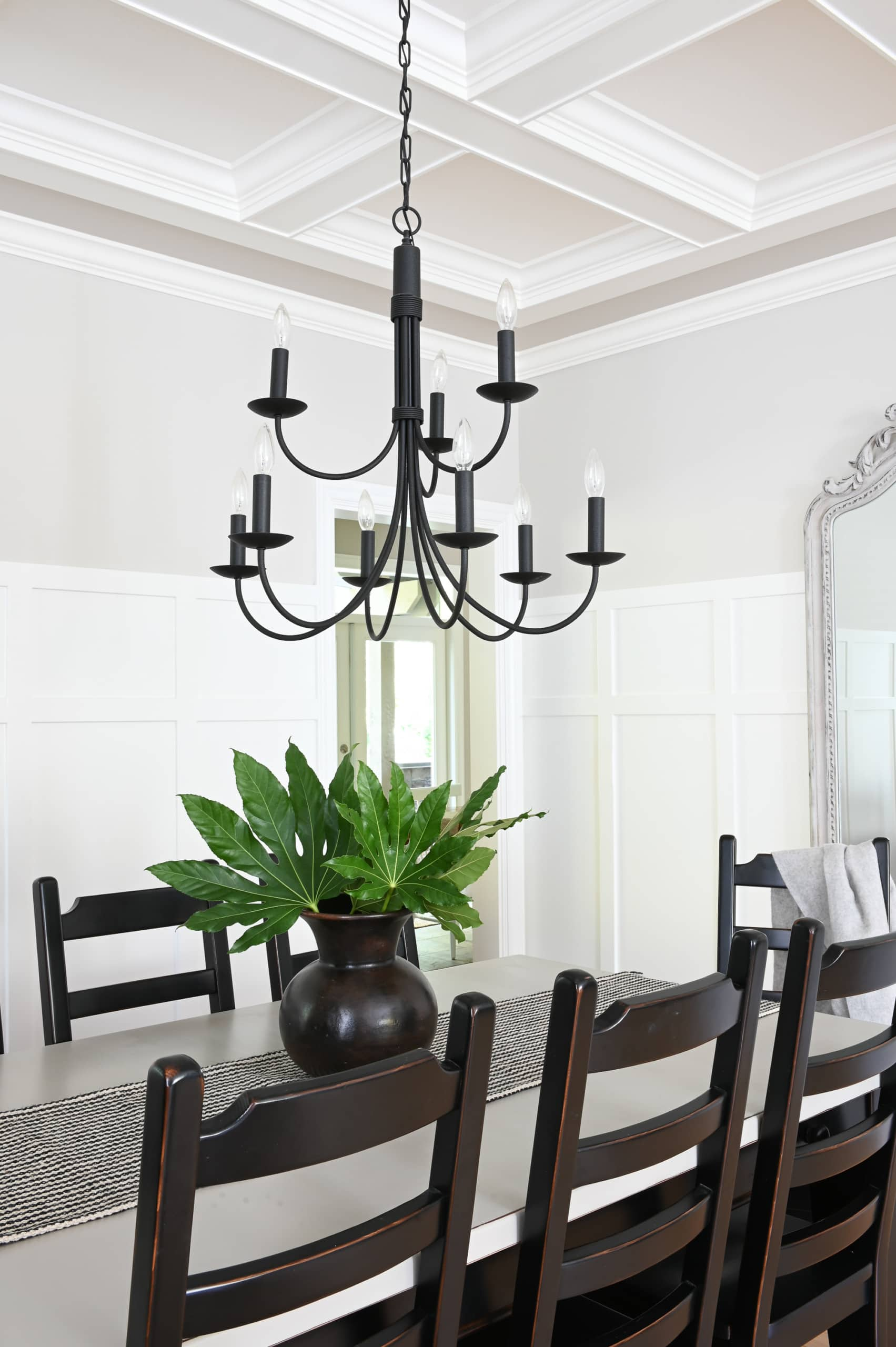 black chandelier over a dining room table