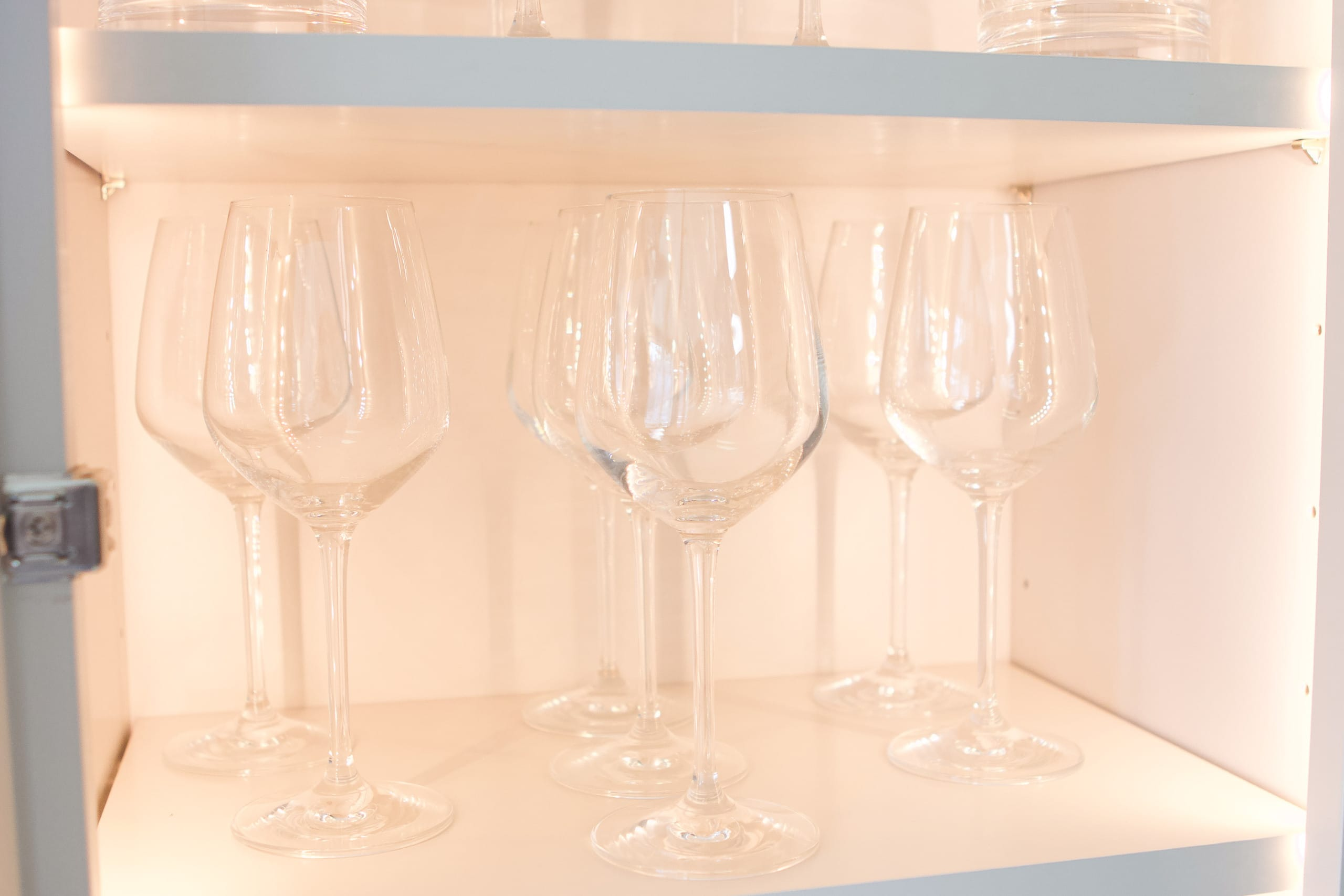 Wine glasses in cabinet
