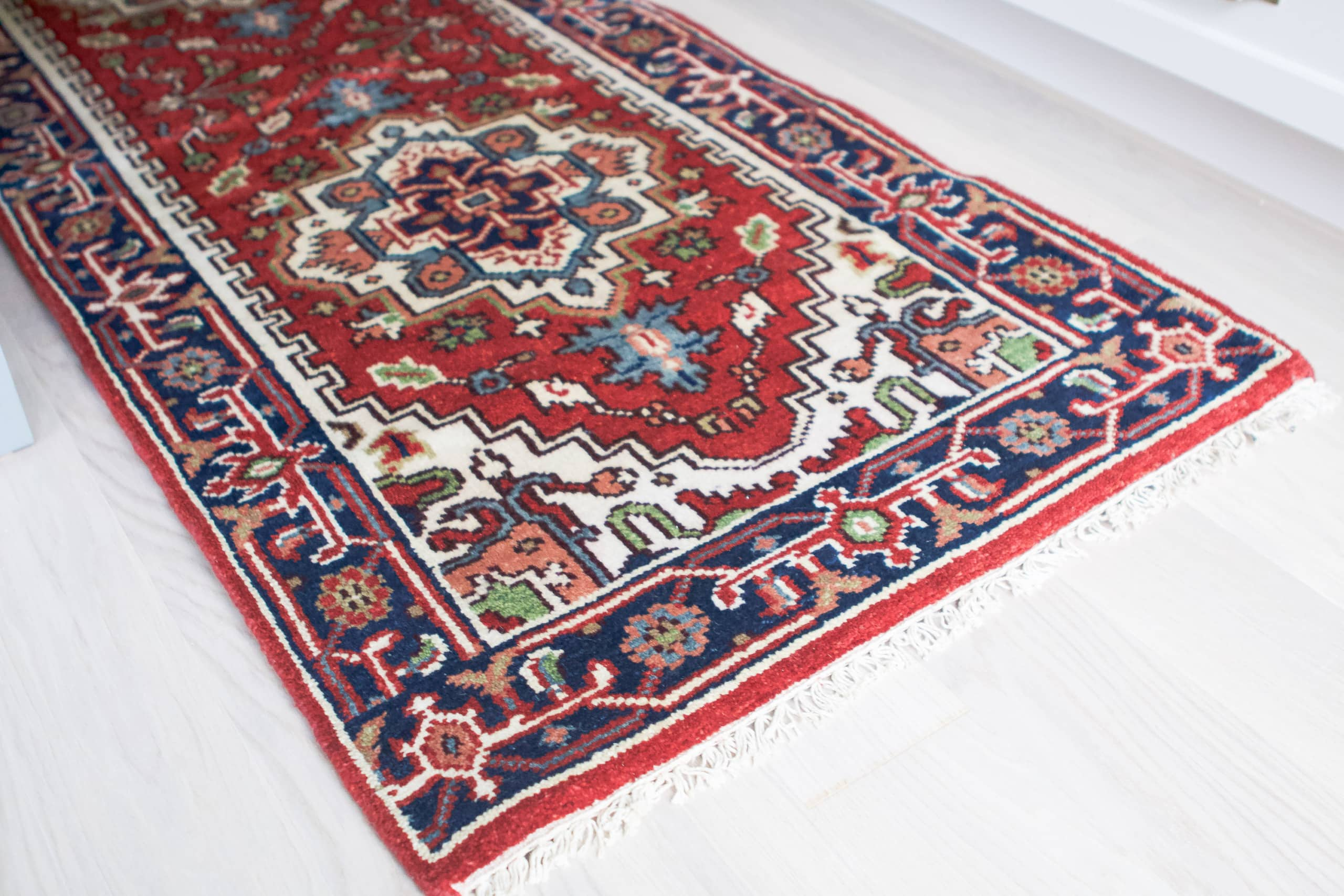 A colorful rug in the kitchen