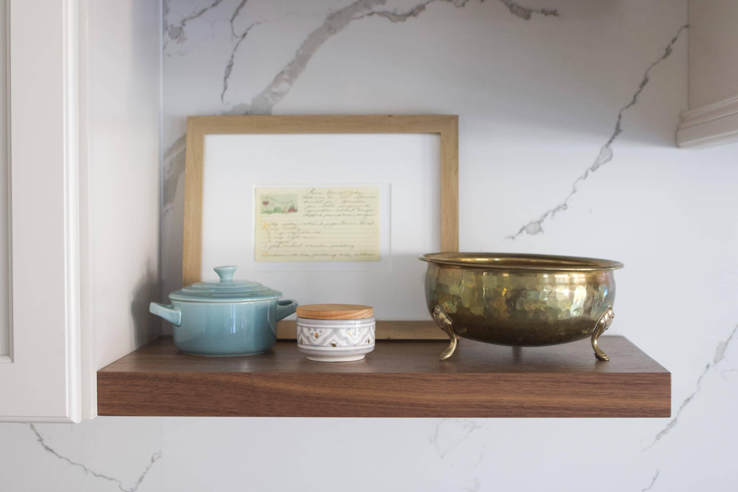 Adding framed recipe cards to the shelves