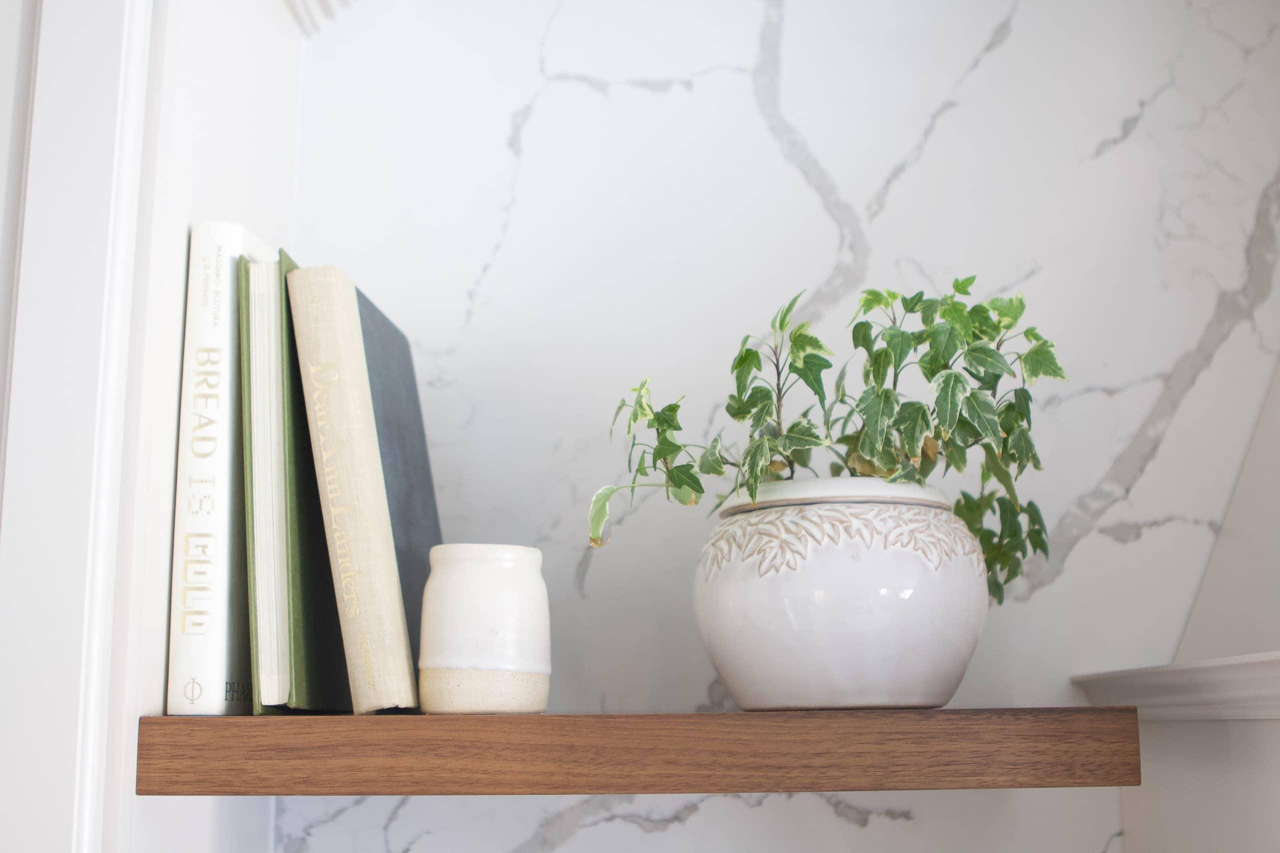 Adding kitchen decor to shelves