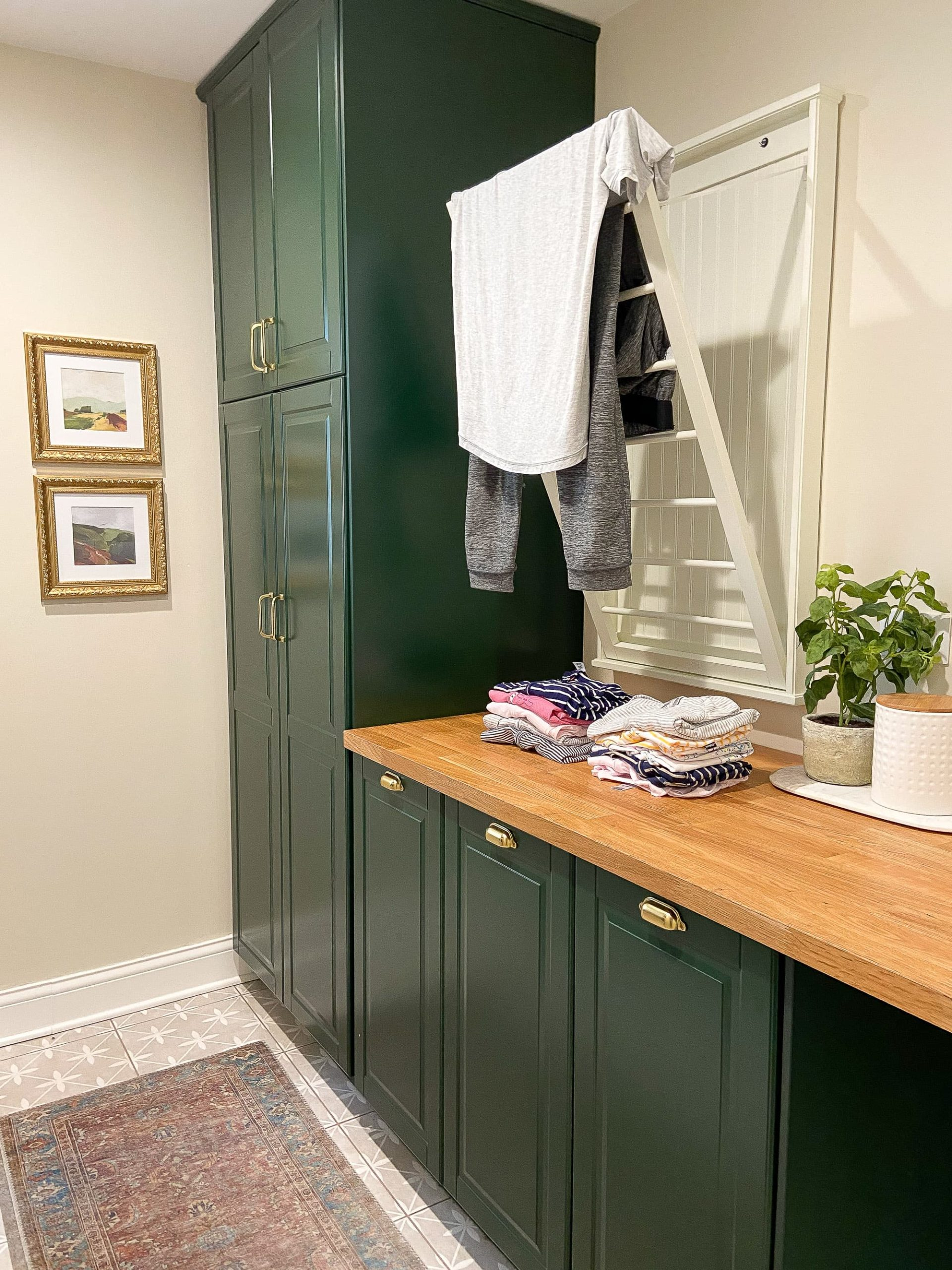 Fold laundry in the laundry room
