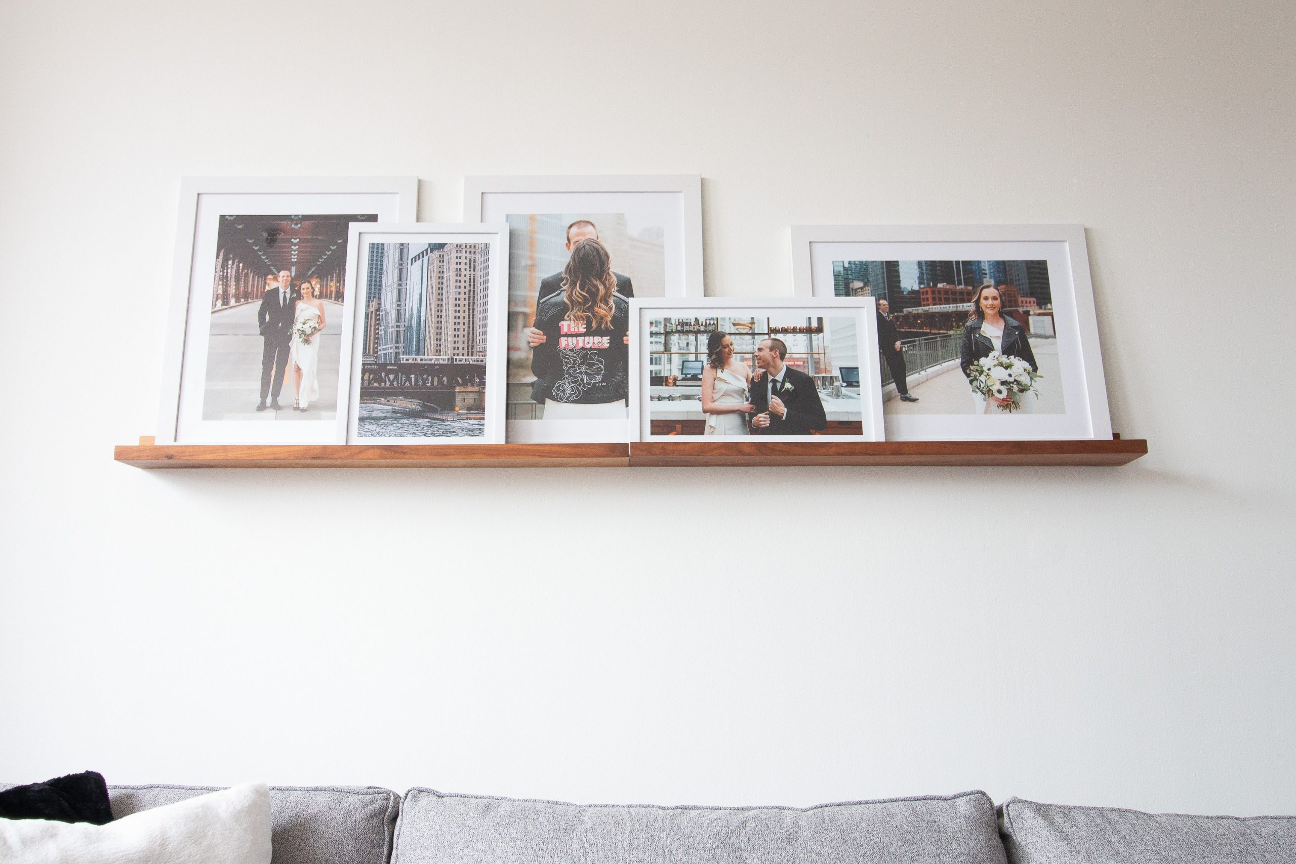 Picture ledge with wedding frames