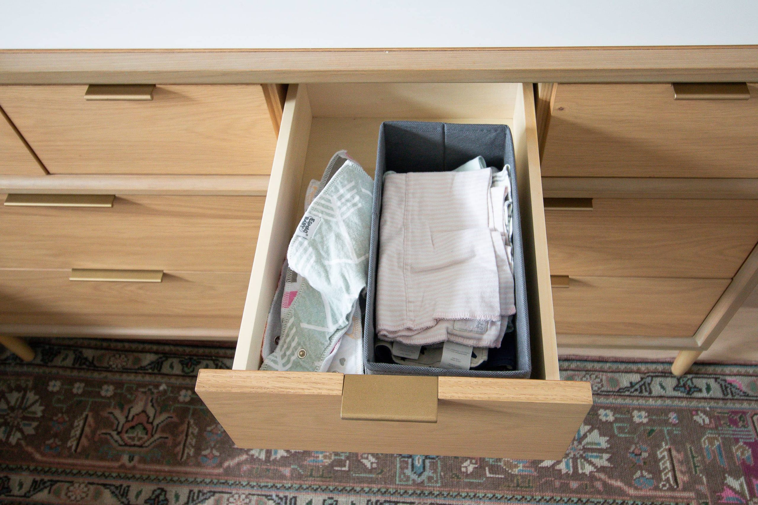 Keeping bibs and wipes organized in a dresser