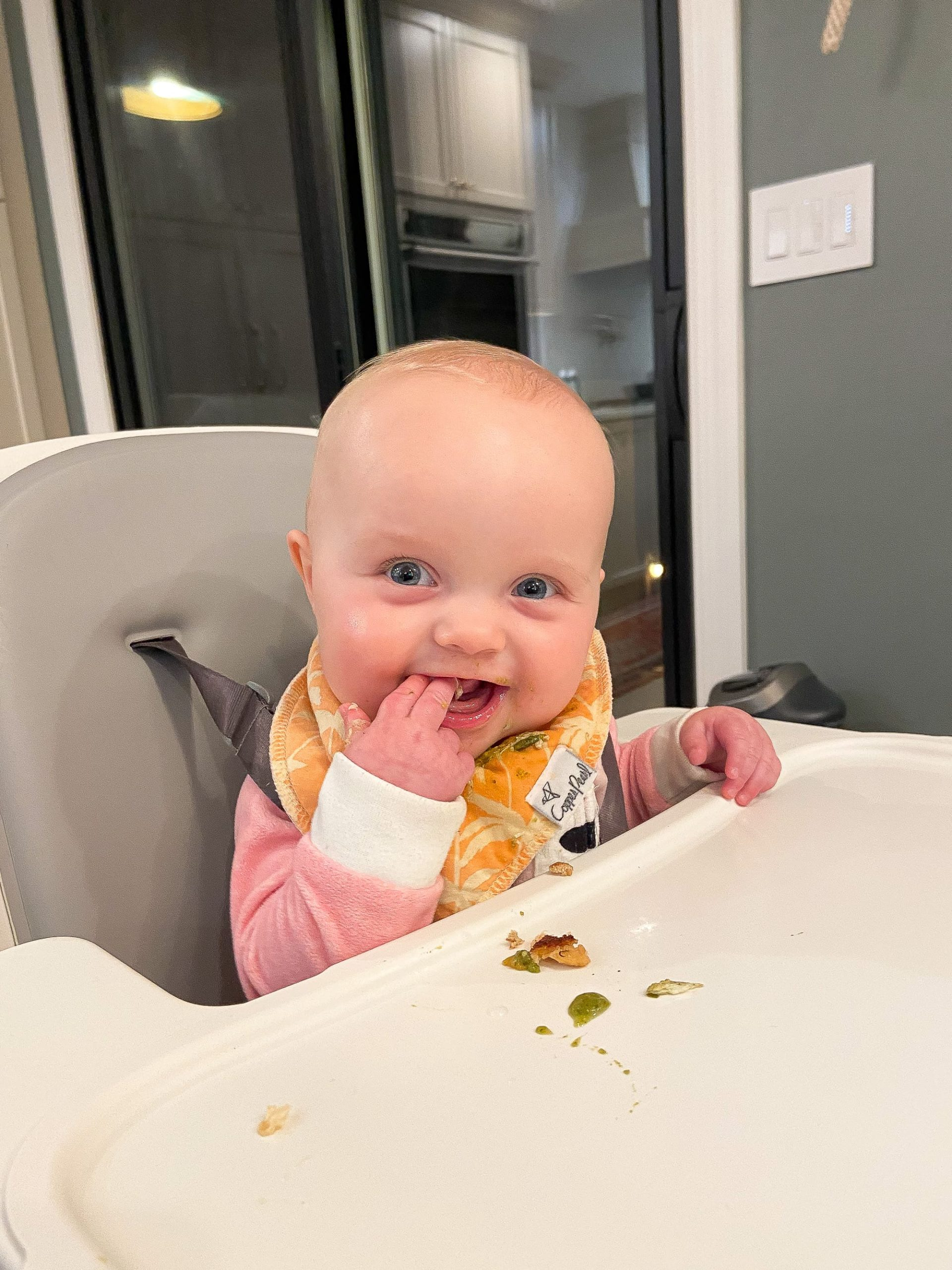 Rory eating with baby led weaning