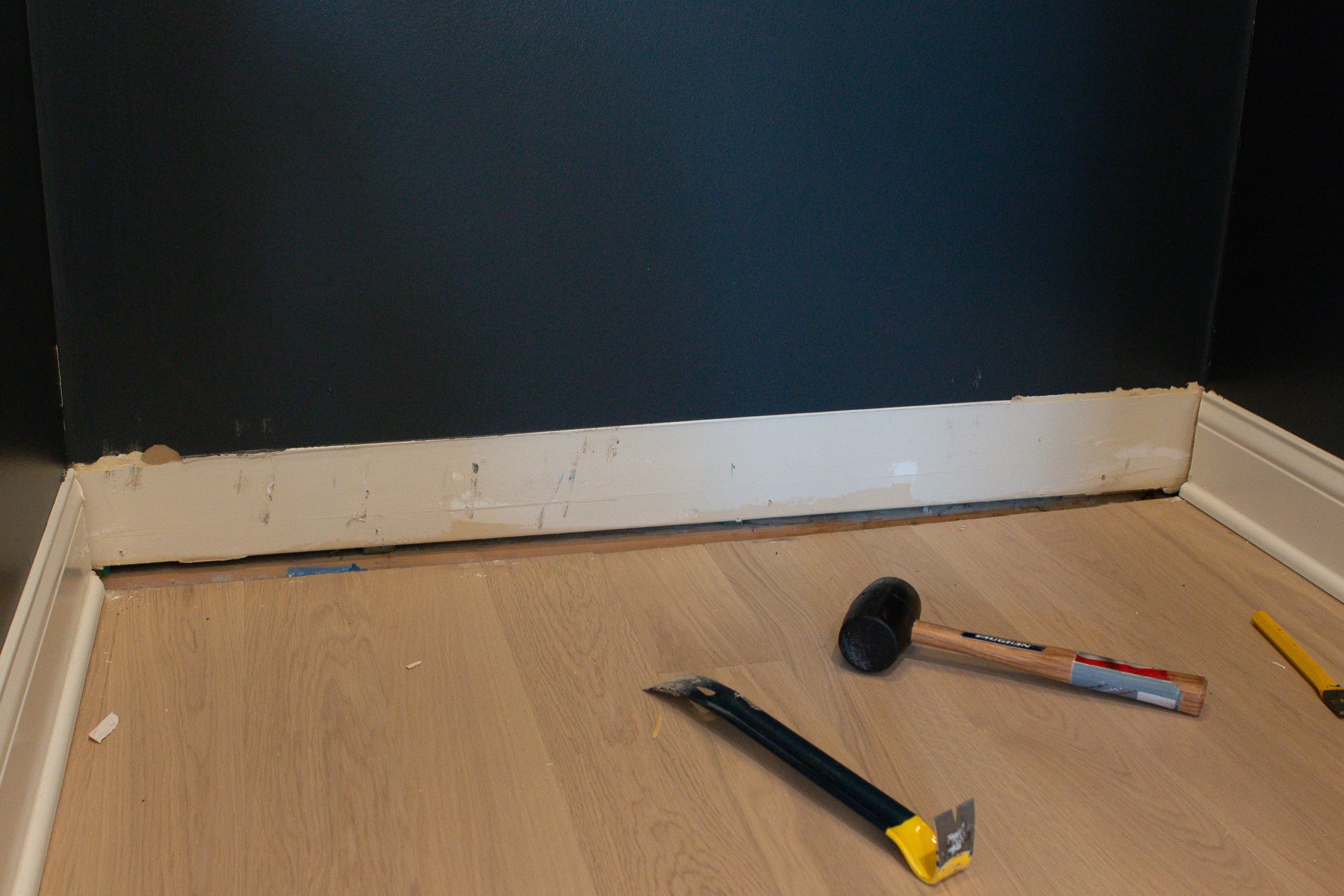 Remove the baseboard when you're installing the IKEA pax