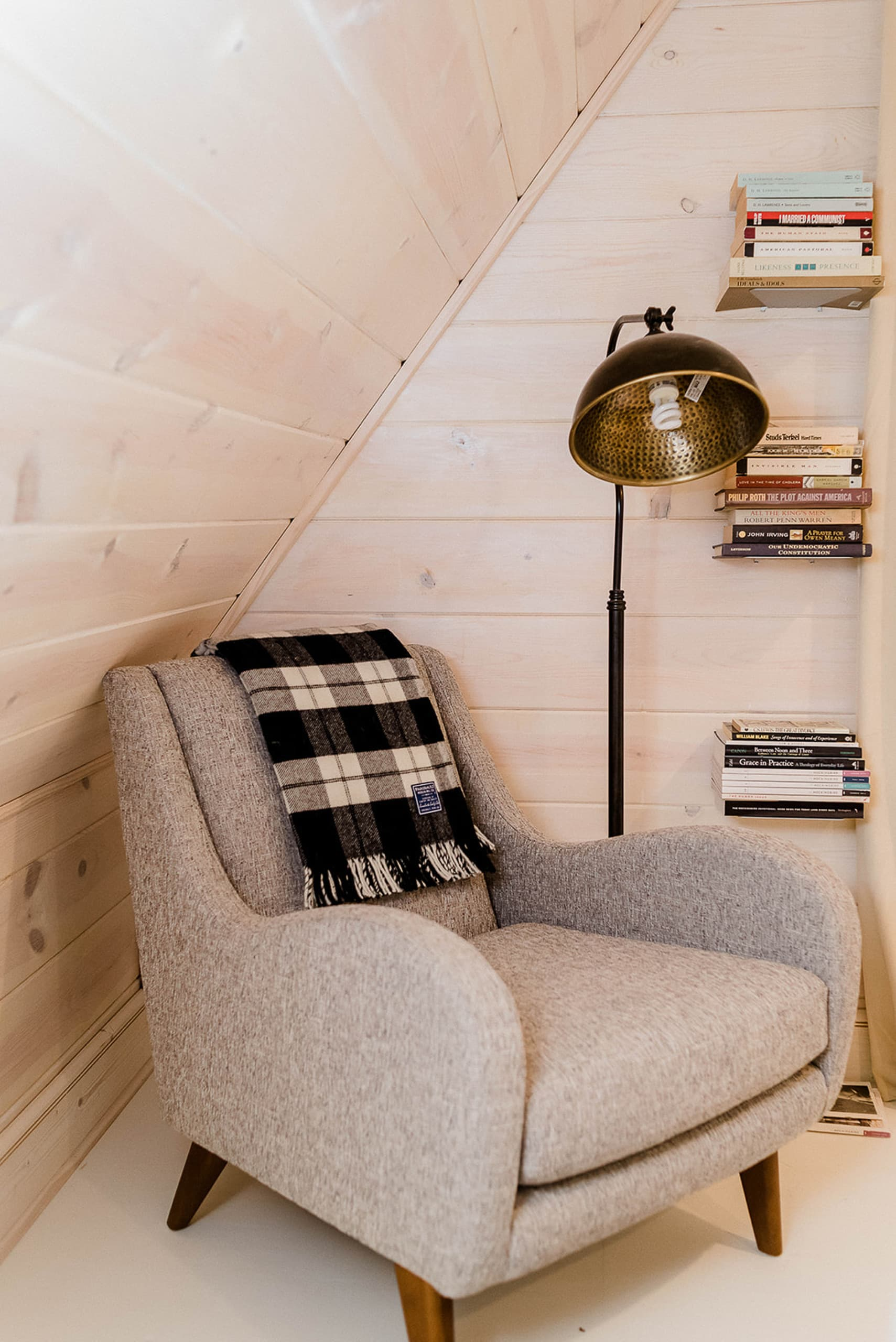 Cute chair in the corner of this bedroom