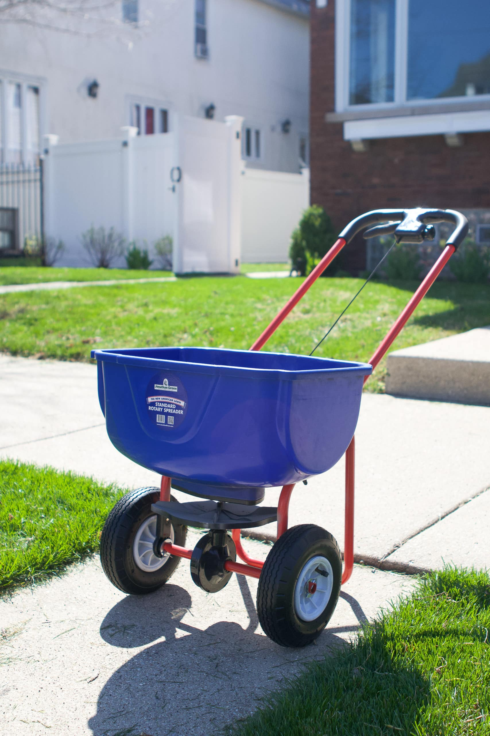 Using a spreader to prep your lawn for spring