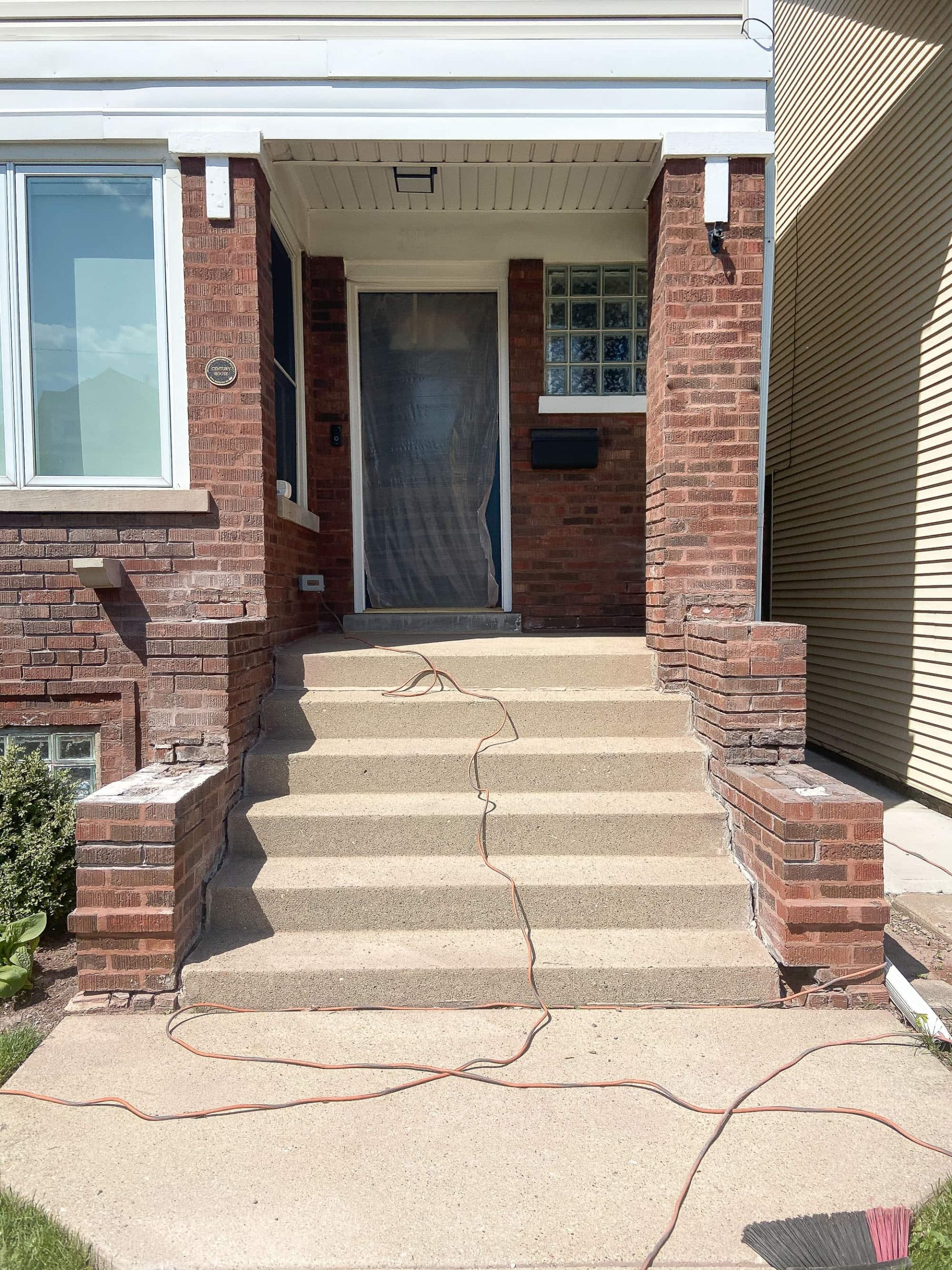 Working on the front porch of our home to repair our crumbling brick and mortar