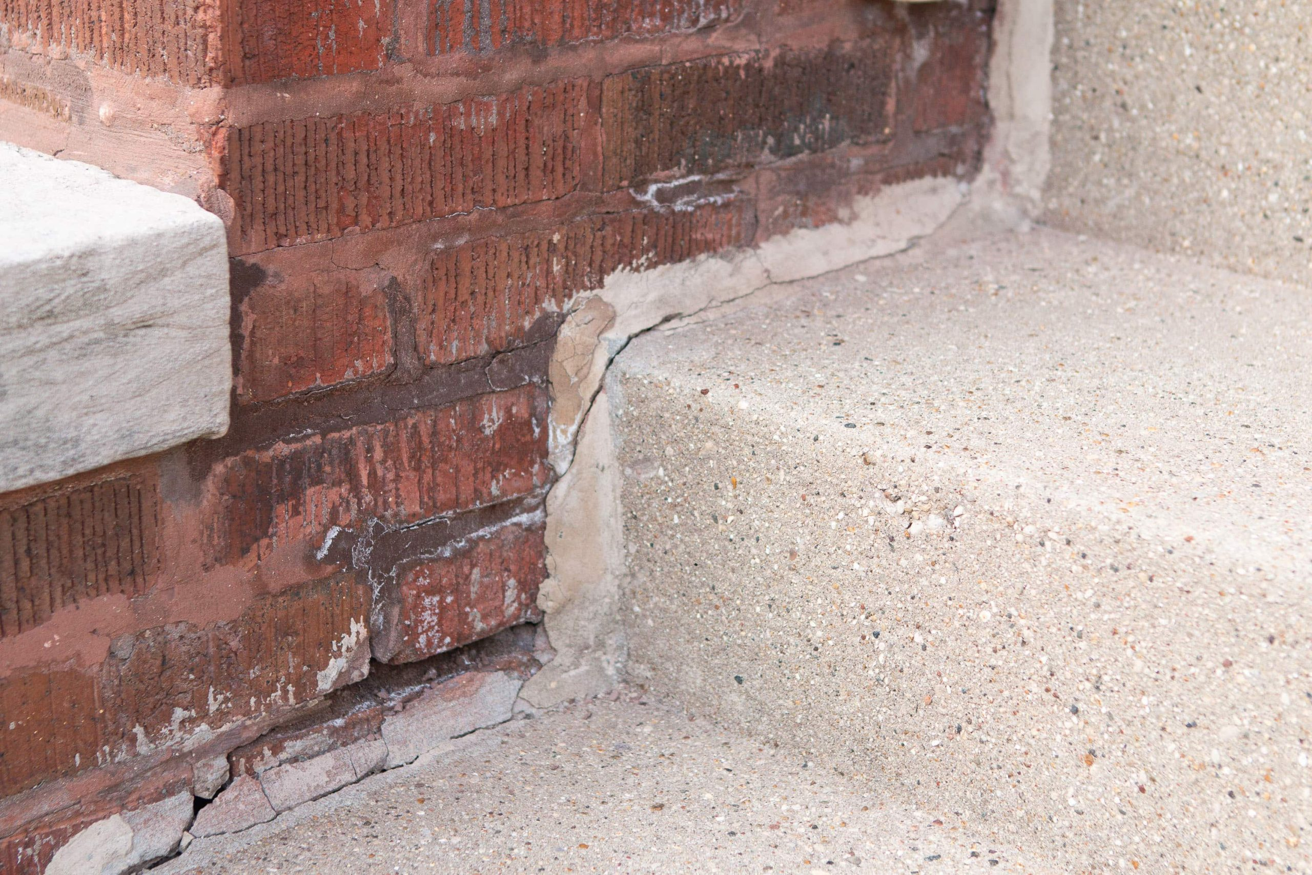 The crumbing brick and mortar on our front porch