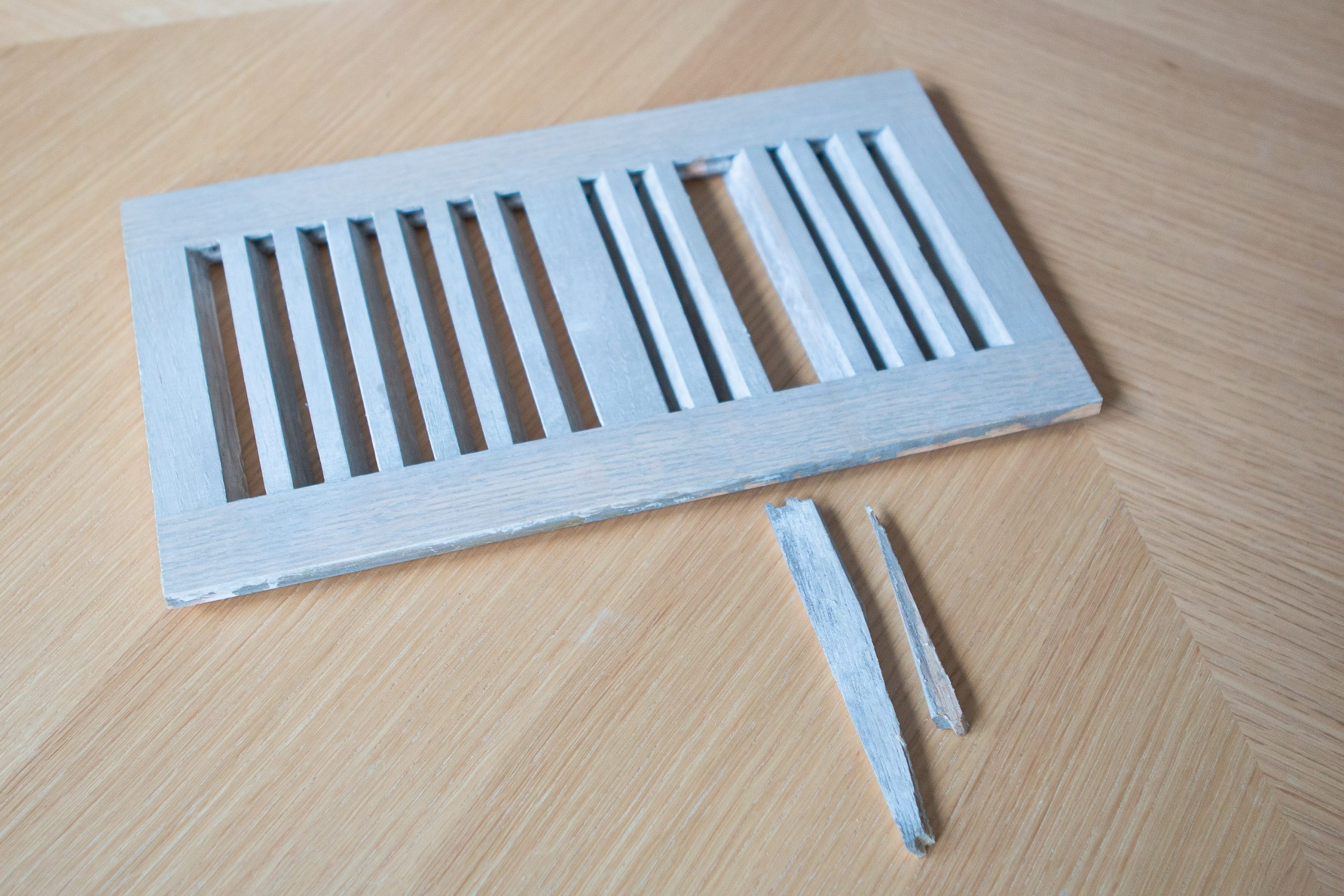 Using super glue to fix our wood floor register