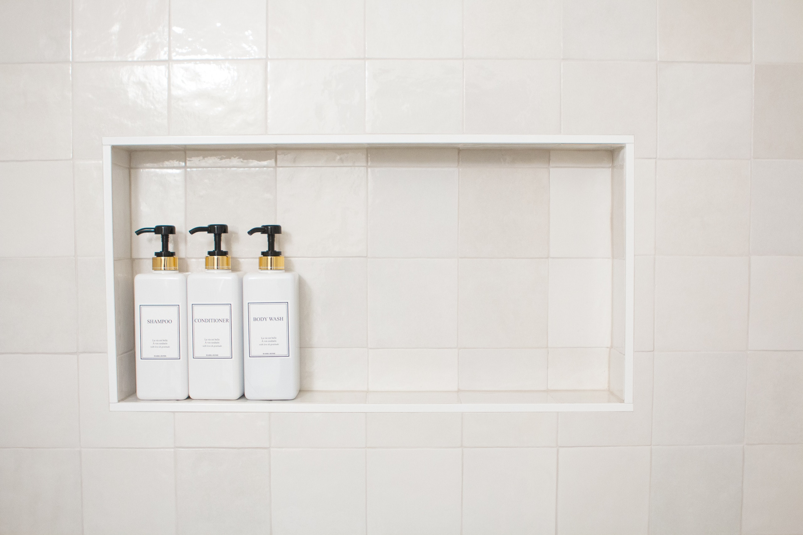 Shower niche with white tile