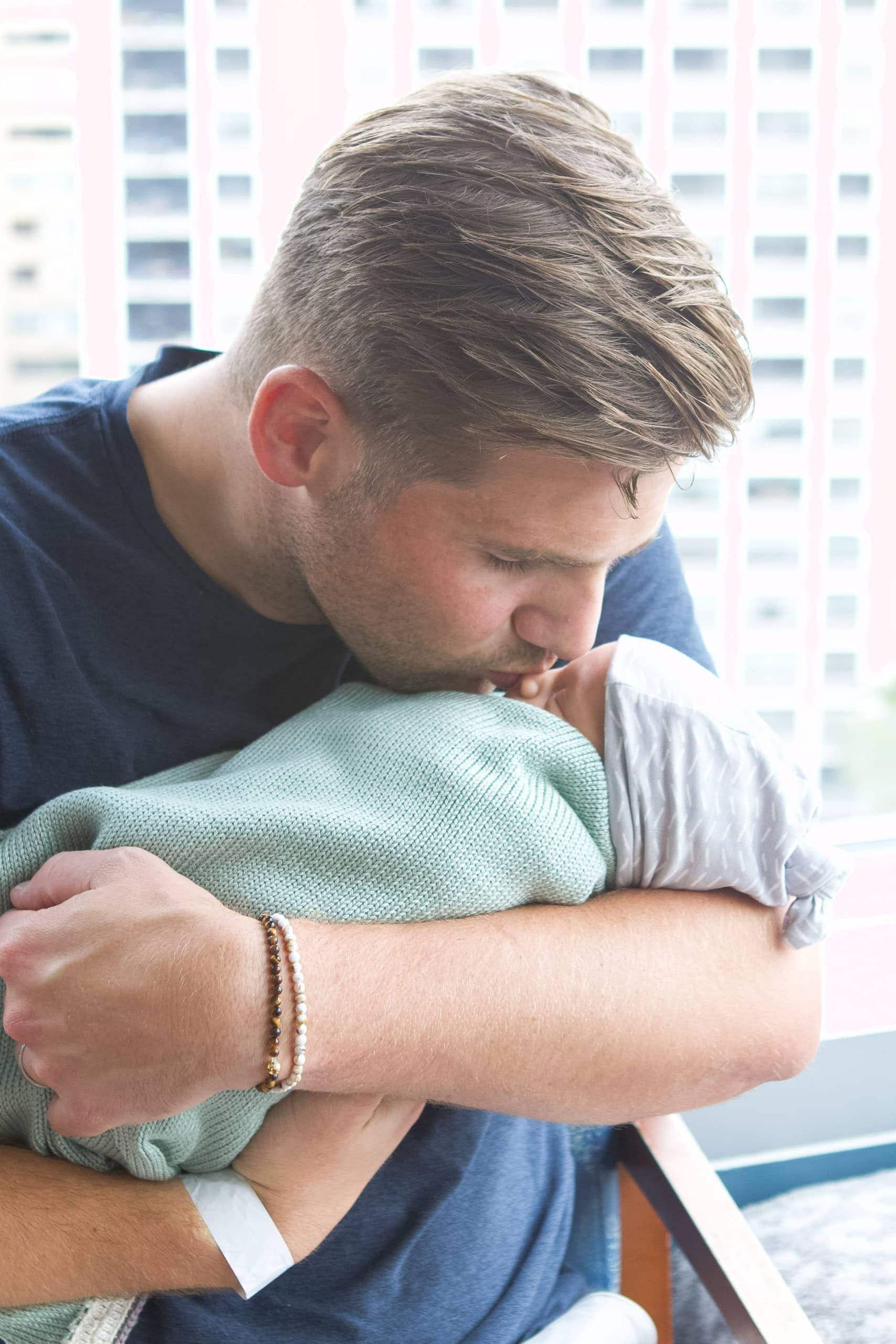 Finn snuggling our baby boy