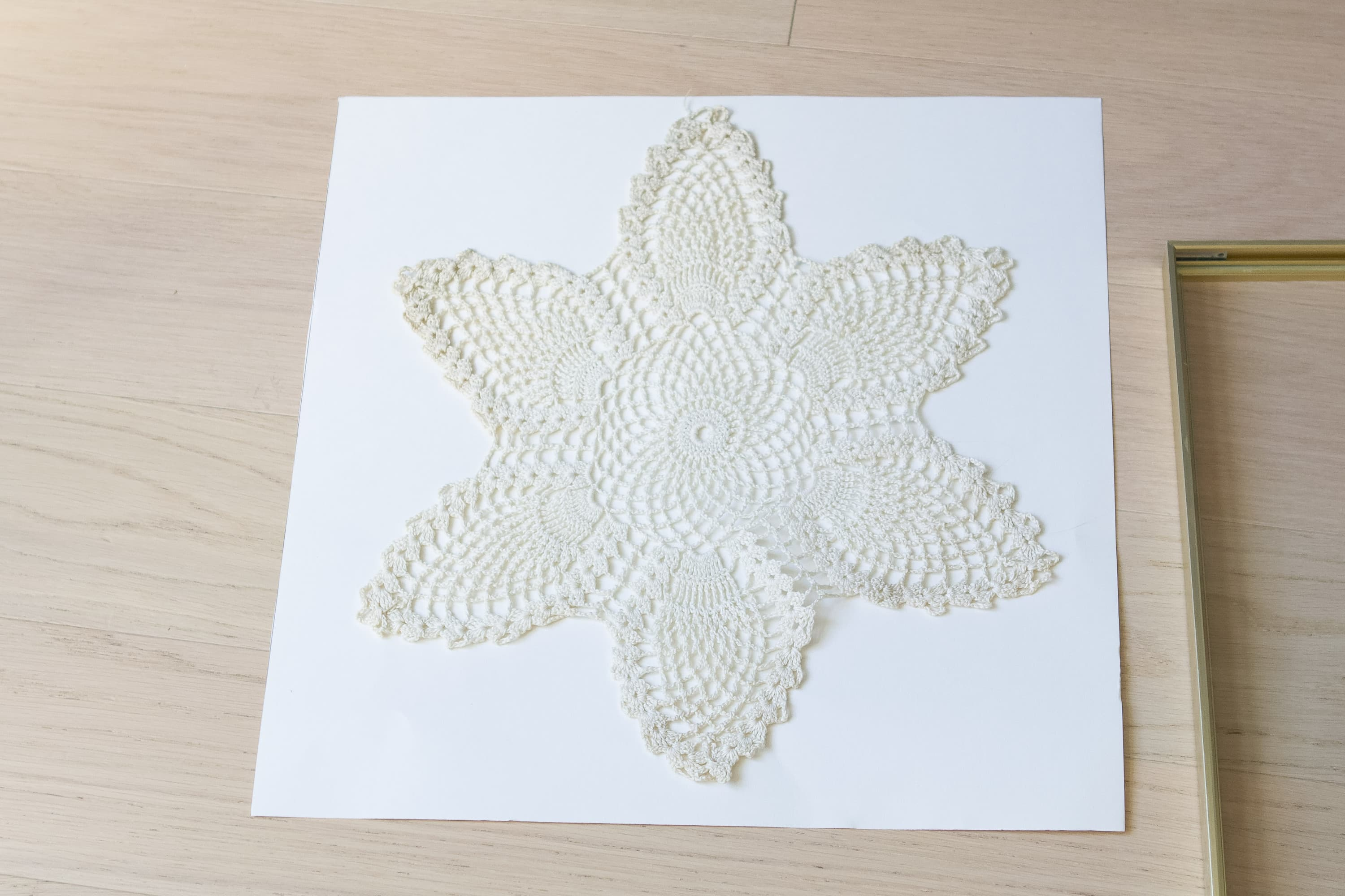 Using posterboard to display my doily